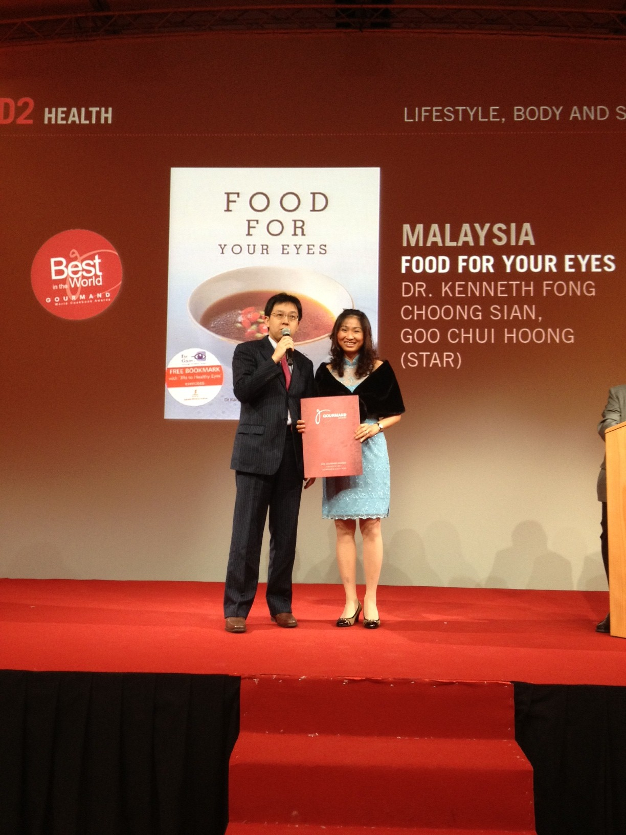 Chui Hoong and myself receiving the award on stage