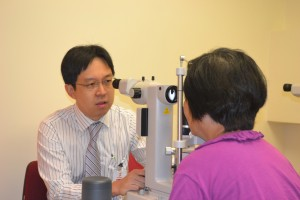 Dr. Fong Treating Patient